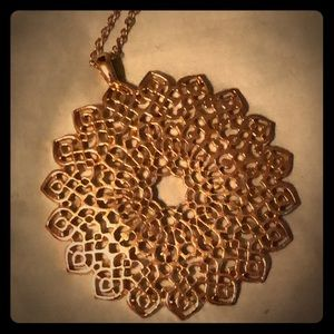 Gold colored medallion fashion necklace.